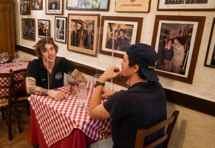 Restart behind plexiglass: Restaurants in Italy prepare for re-opening