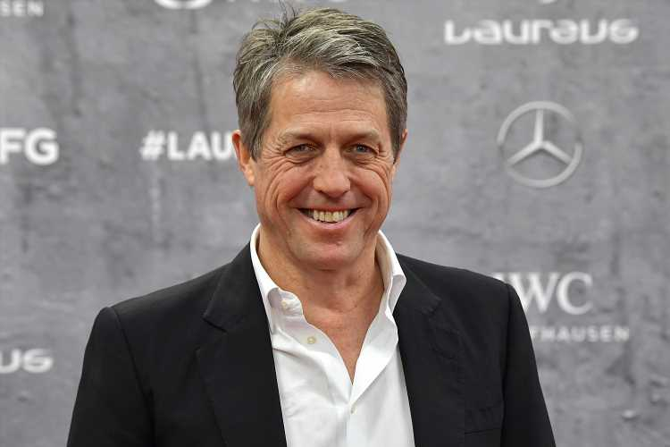 Hugh Grant Jokes About Cutting His Kids' Hair in Quarantine: 'Strapped Them to a Chair'