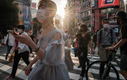 China fights COVID surge as Japan extends emergency during Olympics